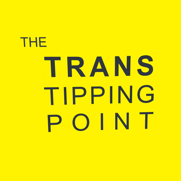 The Trans Tipping Point sign, with a yellow background.